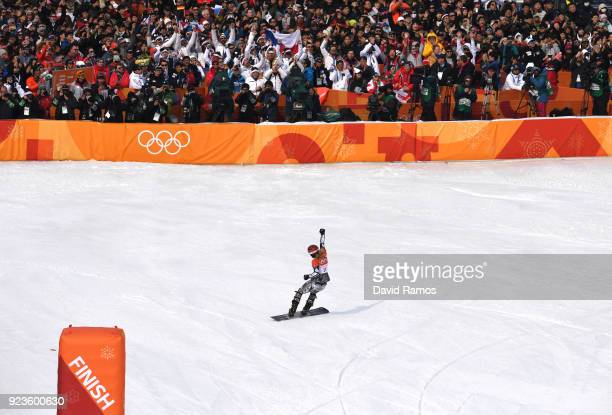 Ester Ledecka of the Czech Republic celebrates winning gold in the Ladies' Snowboard Parallel Giant Slalom Big Final on day fifteen of the...