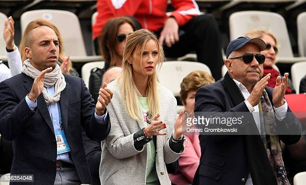Ester Satarova the wife of Tomas Berdych of Czech Republic watches his Men's Singles fourth round match against David Ferrer of Spain on day eleven...