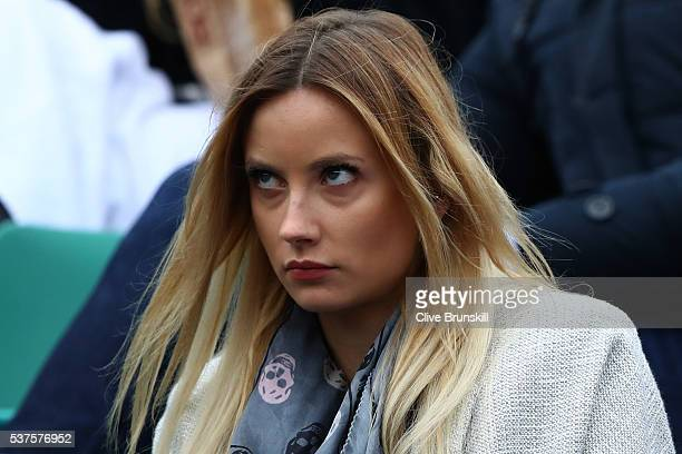 Ester Satarova the wife of Tomas Berdych of Czech Republic watches his Men's Singles quarter final match against Novak Djokovic of Serbia on day...