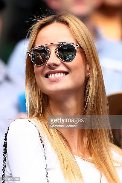 Ester Satorova fiancee of Tomas Berdych of the Czech Republic watches him in his quarterfinal match against Rafael Nadal of Spain during day nine of...