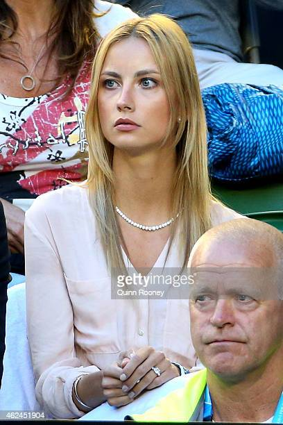 Ester Satorova fiancee of Tomas Berdych of the Czech Republic watches him in his semifinal match against Andy Murray of Great Britain during day 11...