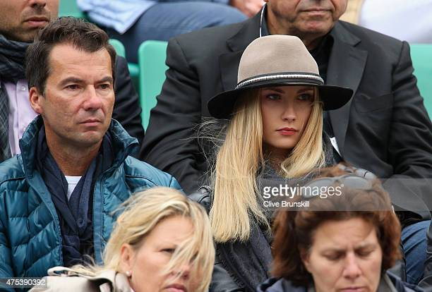 Ester Satorova fiancee of Tomas Berdych of the Czech Republic watches him in his Men's Singles match against JoWilfried Tsonga of France on day eight...