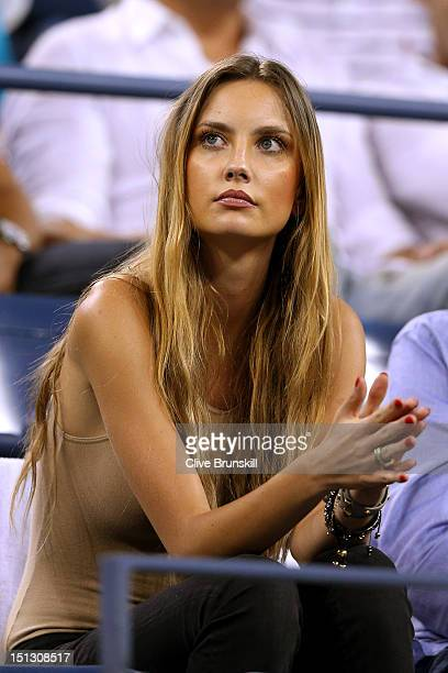 Ester Satorova the girlfriend of Tomas Berdych of Czech Republic watches his men's singles quarterfinal match against Roger Federer of Switzerland on...