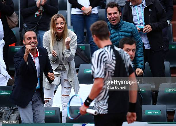Ester Satorova the wife of Tomas Berdych of Czech Republic applauds his victory during the Men's Singles third round match against Pablo Cuevas of...
