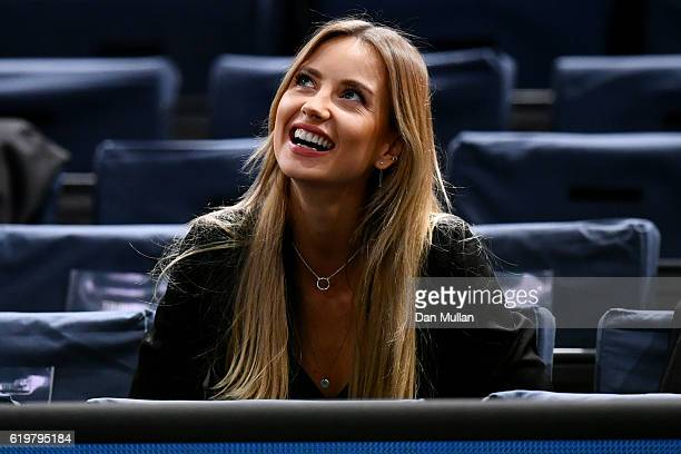 Ester Satorova the wife of Tomas Berdych of the Czech Republic watches his men's singles second round match against Joao Sousa of Portugal on day two...