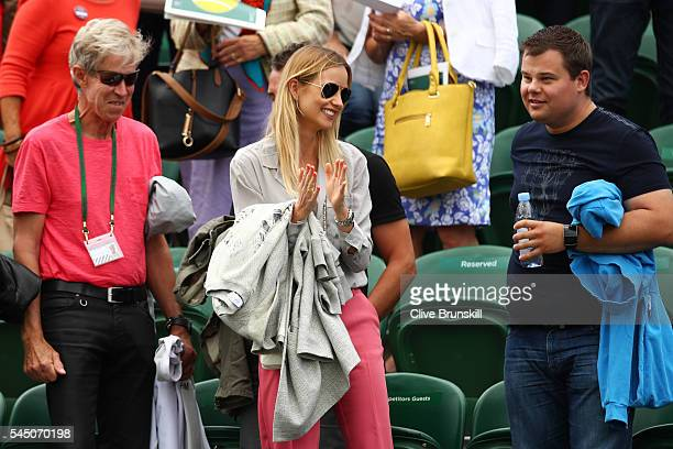 Ester Satorova the wife of Tomas Berdych of The Czech republic looks on during day eight of the Wimbledon Lawn Tennis Championships at the All...