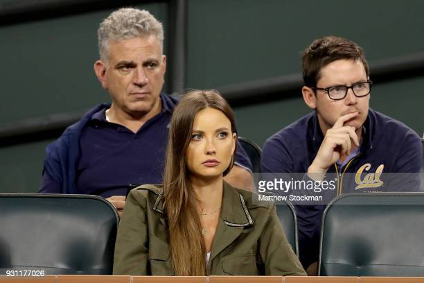 Ester Satorova watches Tomas Berdych of Czech Republic play Hyeon Chung of Korea during the BNP Paribas Open at the Indian Wells Tennis Garden on...
