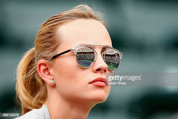Ester Satorova wife of Tomas Berdych of Czech Republic looks on in the match against Lukas Rosol of Czech Republic during day ten of the BNP Paribas...