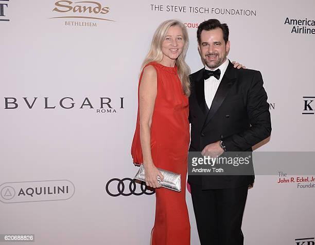 Ester Velo Van Hulst and International Communications Director for Bulgari Stephane Gerschel wears Bulgari to the Elton John AIDS Foundation's 15th...