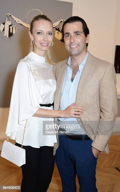 Estera Lussato and Pierre Lussato attend the Bansky 'Greatest Hits 20022008' exhibition VIP preview at Lazinc on July 9 2018 in London England