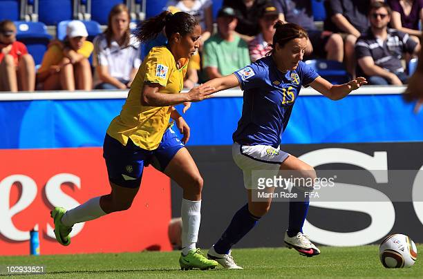 Estergiane L of Brazil and Antonia Goransson R of Sweden compete for the ball during the 2010 FIFA Women's World Cup Group B match between Brazil and...