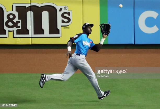 Estevan Florial of the New York Yankees and the World Team catches a ball hits a by Bo Bichette of the Toronto Blue Jays and the US Team for an out...