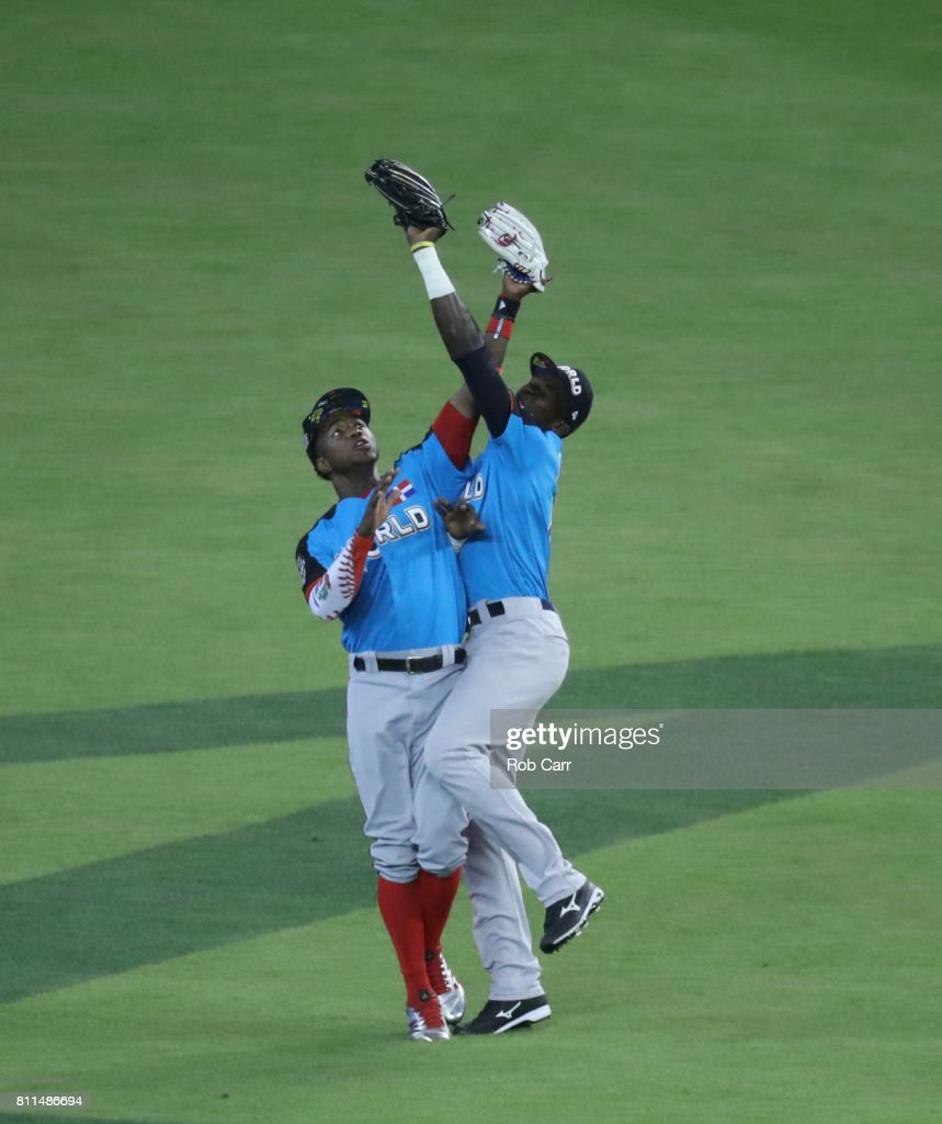 Estevan Florial #8 of the New York Yankees and the World Team catches the ball over teammate Victor Robles #16 of the Washington Nationals against the U.S. Team during the SiriusXM All-Star Futures Game at Marlins Park on July 9, 2017 in Miami, Florida.