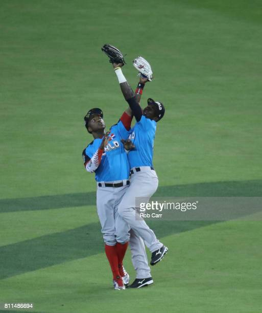 Estevan Florial of the New York Yankees and the World Team catches the ball over teammate Victor Robles of the Washington Nationals against the US...