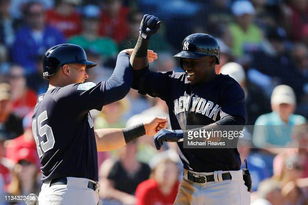 Estevan Florial of the New York Yankees celebrates with Luke Voit after hitting a three-run home run in the sixth inning against the Philadelphia...