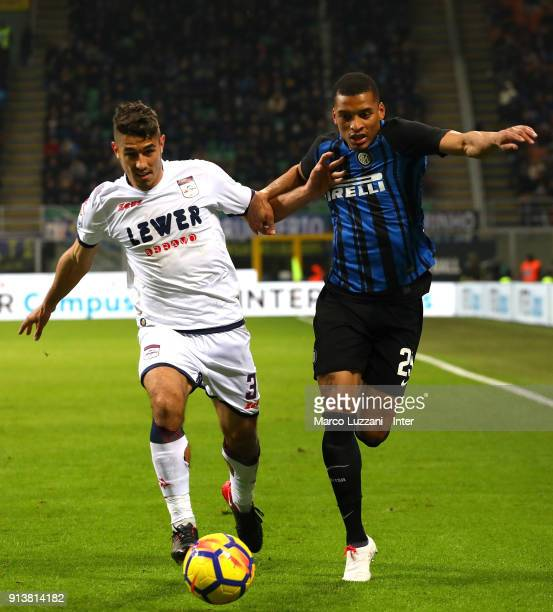 Estevao Dalbert of FC of Internazionale competes for the ball with Davide Faraoni of FC Crotone during the serie A match between FC Internazionale...