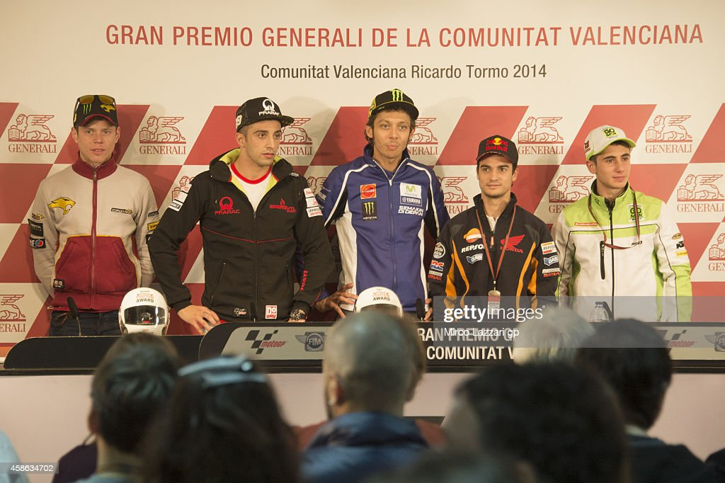 Esteve Rabat of Spain and Marc VDS Racing Team, Andrea Iannone of Italy and Pramac Racing, Valentino Rossi of Italy and Movistar Yamaha MotoGP, Dani Pedrosa of Spain and Repsol Honda Team, Niccolo Antonelli of Italy and Junior Team Go&Fun Moto3 pose during the press conference during the MotoGP of Valencia - Qualifying at Ricardo Tormo Circuit on November 8, 2014 in Valencia, Spain.