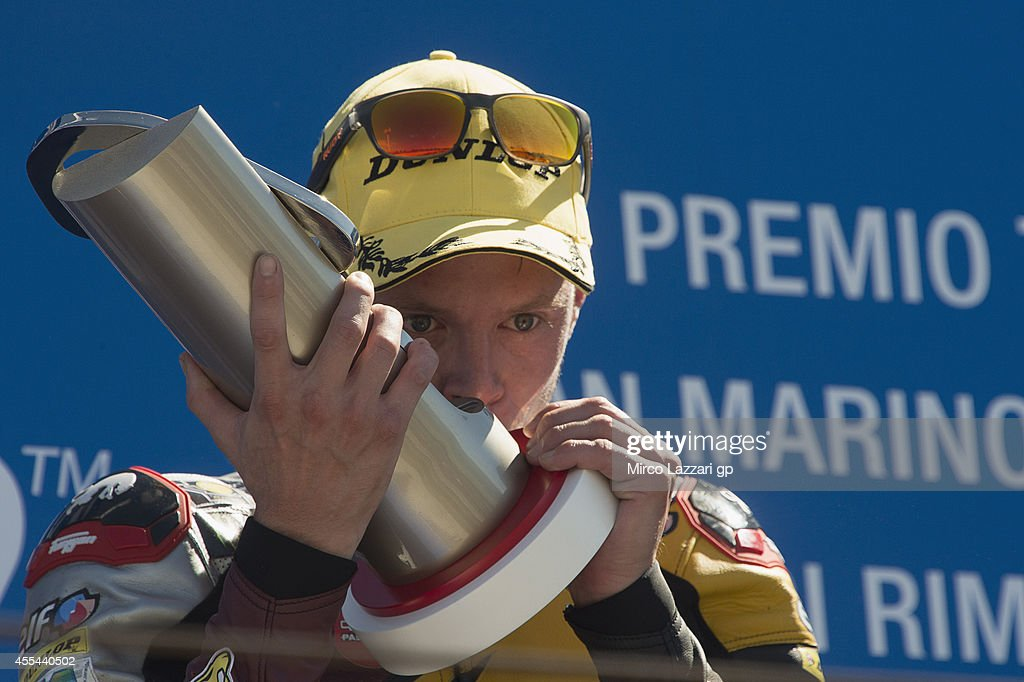 Esteve Rabat of Spain and Marc VDS Racing Team smiles and celebrates the victory on the podium at the end of the Moto2 race during the MotoGP of San Marino - Race at Misano World Circuit on September 14, 2014 in Misano Adriatico, Italy.