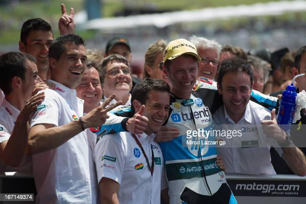 Esteve Rabat of Spain and Pons 40 HP Tuenti celebrates under the podium with team the second place in Moto2 class at the end of the Moto2 race during...
