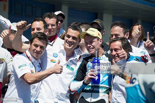 Esteve Rabat of Spain and Pons 40 HP Tuenti celebrates under the podium with team at the end of the Moto2 Race during the MotoGp of Spain Race at...