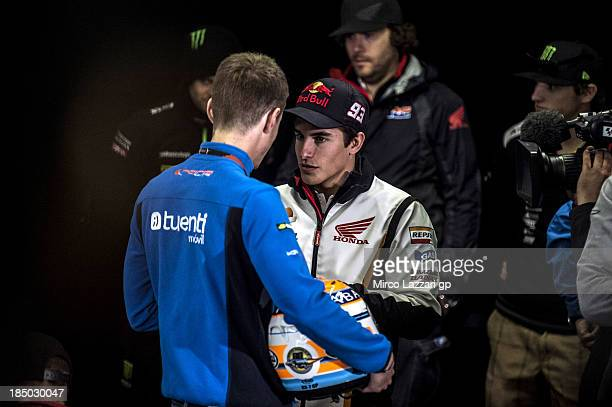 Esteve Rabat of Spain and Pons 40 HP Tuenti speaks with Marc Marquez of Spain and Repsol Honda Team during the press conference ahead of the 2013...