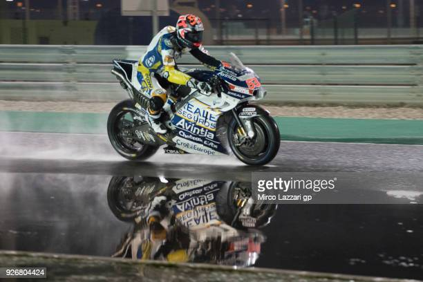 Esteve Rabat of Spain and Reale Avintia Racing heads down a straight and test the wet track during the Moto GP Testing Qatar at Losail Circuit on...