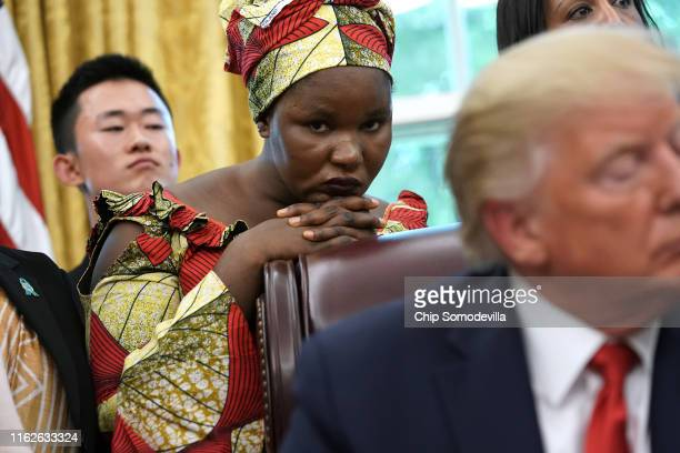 Esther Bitrus who was kidnapped by Boko Haram in 2014 in Nigeria listens as US President Donald Trump hosts her and other survivors of religious...