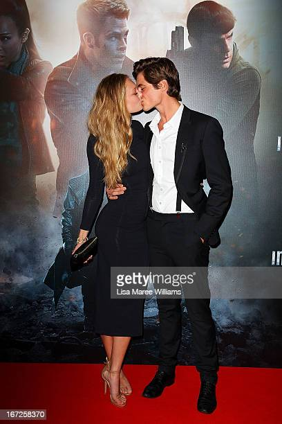 Esther Cronin and Piers Hampton kiss on the red carpet at the Australian premiere of 'Star Trek Intro Darkness' at Event Cinemas on April 23 2013 in...