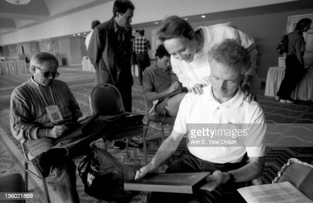 Esther Dyson from EDventure Holdings looks over the shoulder of Larry Tesler from Apple Computer as he uses a pen tablet computer at the annual PC...
