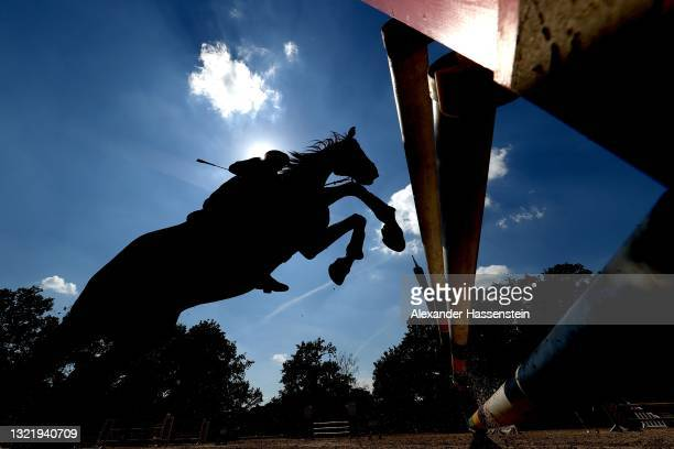 Esther Fernandez Donda of Germany riding La Caleca during the Riding Show Jumping in the Women's Modern Pentathlon Open German Championships during...