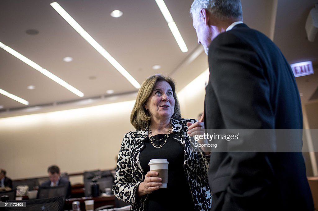 Esther George, president and chief executive officer of the Kansas City Federal Reserve Bank, left, speaks with an attendee during the Federal Reserve Bank Of Chicago's Annual Payments Symposium in Chicago, Illinois, U.S., on Wednesday, Oct. 12, 2016. George said 'dynamic, persistent and escalating threats are challenging public confidence in the U.S. payment system.' Photographer: Christopher Dilts/Bloomberg via Getty Images