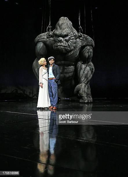 Esther Hannaford who plays Ann Darrow and Chris Ryan who plays Jack Driscoll pose with King Kong on stage during a King Kong production media call at...