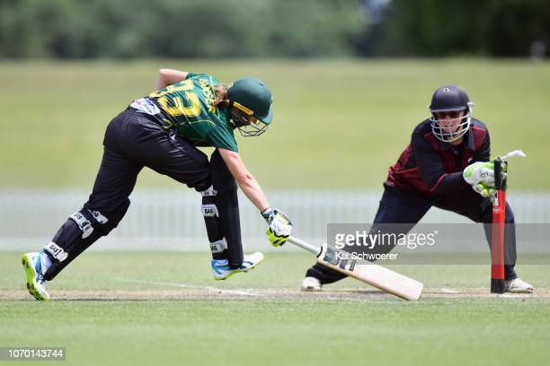 Esther Lanser of the Central Hinds is run out during the Hallyburton Johnstone Shield match between the Canterbury Magicians and the Central Hinds at...