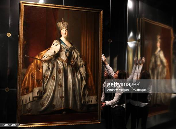 Esther Lynn from the National Museum of Scotland in Edinburgh puts the finishing touches to an oil painting of Catherine II in her Coronation Robes...
