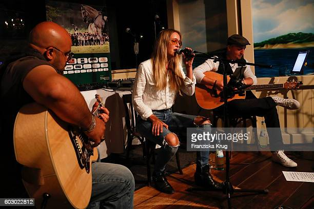 Esther Nikolai Seibt and Davis Hason perform at the Till Demtroders CharityEvent 'Usedom Cross Country' on September 10 2016 near Heringsdorf in...
