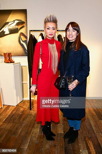 Esther Quek and guest attended the Bally Men's Autumn Winter 2016 Presentation on January 17 2016 in Milan Italy
