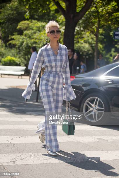 Esther Quek in a checkered Madiyah Al Sharqi suit and Prada sunglasses outside the Dior Homme show at Grand Palais on June 24 2017 in Paris France