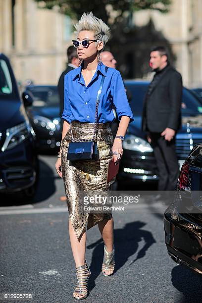 Esther Quek is wearing a blue shirt and a gold skirt outside the Miu Miu show during Paris Fashion Week Spring Summer 2017 on October 5 2016 in Paris...