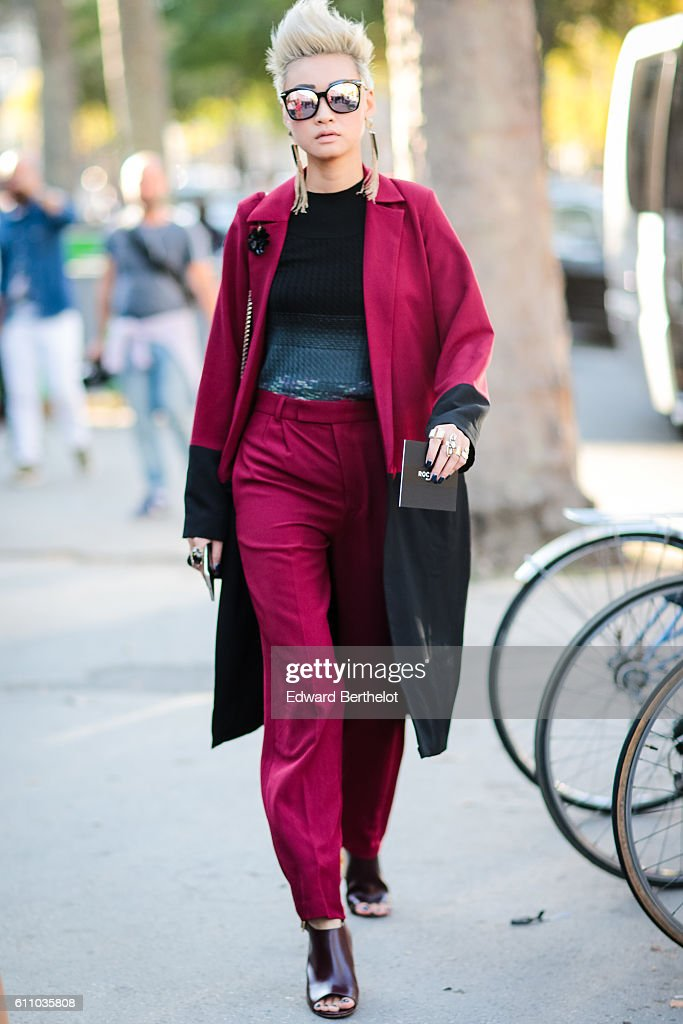 Esther Quek is wearing a red coat, red pants, and sunglasses, outside the Rochas show, at the Palais de Tokyo, during Paris Fashion Week Spring Summer 2017, on September 28, 2016 in Paris, France.
