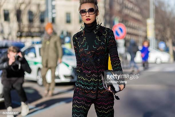 Esther Quek outside Armani during Milan Men's Fashion Week Fall/Winter 2016/17 on January 18 in Milan Italy