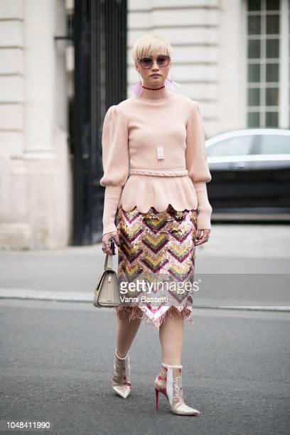 Esther Quek poses after the Miu Miu show at the Palais de Iena during Paris Fashion Week SS19 Womenswear on October 2 2018 in Paris France