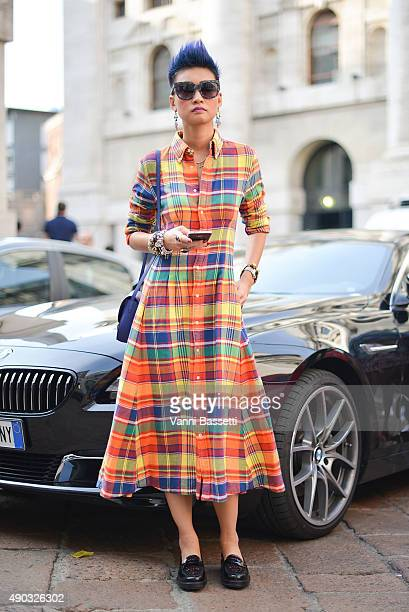Esther Quek poses wearing a Ralph Lauren dress before the Salvatore Ferragamo show during the Milan Fashion Week Spring/Summer 16 on September 27...