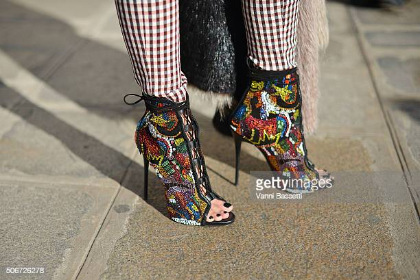 Esther Quek poses wearing Victoria Beckam pants and Giuseppe Zanotti shoes before the Miu Miu presentation at Place Beauvau on January 25 2016 in...