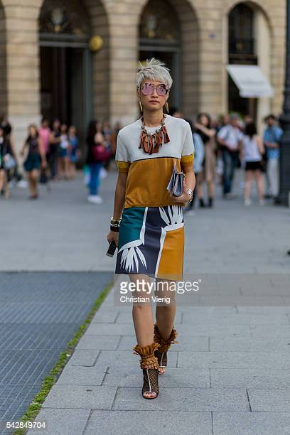 Esther Quek wearing a Fendi dress outside Cerruti during the Paris Fashion Week Menswear Spring/Summer 2017 on June 24 2016 in Paris France