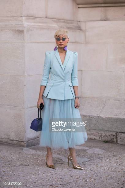 Esther Quek wearing a light blue blazer with a matching tulle skirt bronze heels and grey bag is seen after the Elie Saab show on September 29 2018...