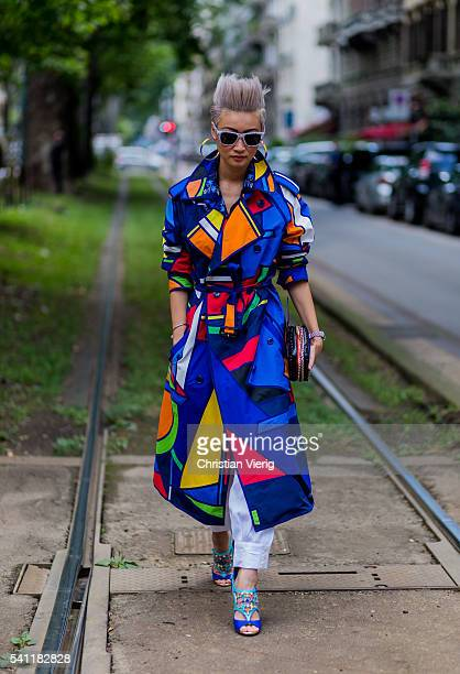 Esther Quek wearing a multi color Ralph Lauren cpat Louboution heels and Dolce Gabbana sunglasses outside Dolce Gabbana during the Milan Men's...
