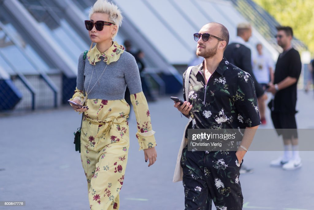 Esther Quek wearing a yellow jumpsuit, cropped knit above it outside Lanvin during Paris Fashion Week Menswear Spring/Summer 2018 Day Five on June 25, 2017 in Paris, France.