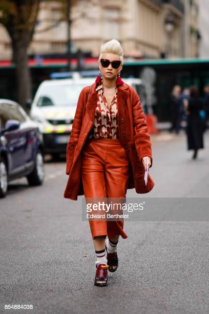 Esther Quek wears a red coat a shirt cropped leather pants outside Lanvin during Paris Fashion Week Womenswear Spring/Summer 2018 on September 27...