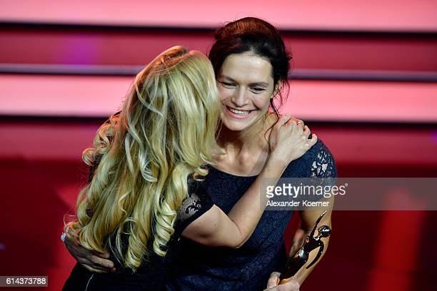 Esther Ridder of 'Raise a smile e.V.' and Andrea Kaiser during the 'Goldene Bild der Frau' award at Stage Theater on October 13, 2016 in Hamburg,...