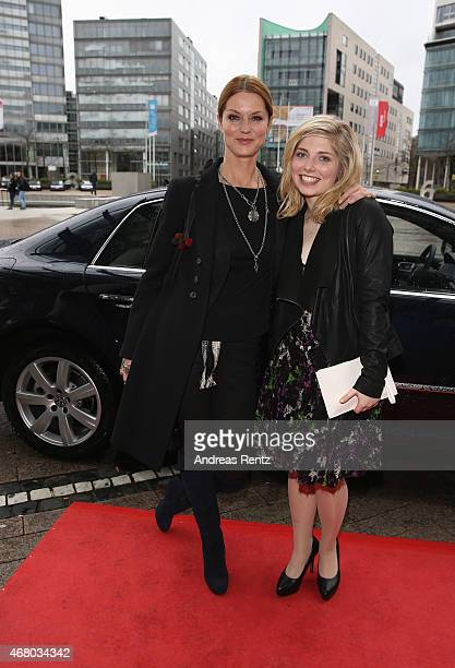 Esther Schweins and Lilian Prent attend the German premiere of the film 'Mara und der Feuerbringer' at Cinedom on March 29 2015 in Cologne Germany